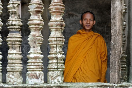 Stone columns and Buddhist monk in Angkor Wat, Cambodia