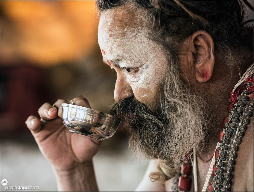 Holy man - Sadhu - drinking tea, Haridwar, India