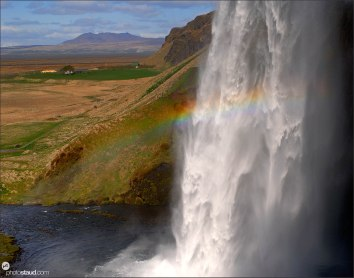 Landscape of Iceland, Rainbow over Seljalandsfoss waterfall, Iceland